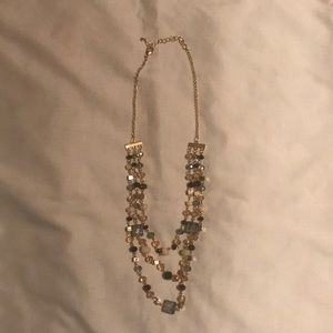 Three strand gold toned necklace